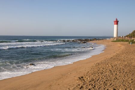 Stretch of footprinted beach leading up to the umhlanga lighthouse
