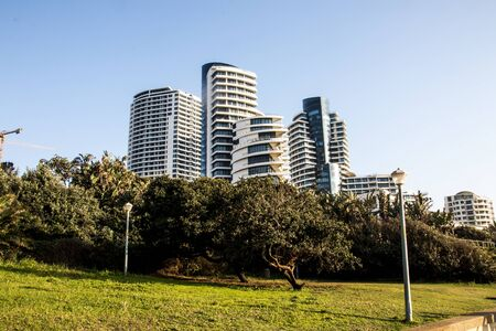 Upmarket tall residential buildings and hotels line the beach in umhlanga rocks, kwazulu-natal south africa