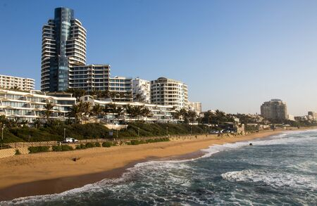 Residential buildings and hotels line the shoreline in upmarked umhlanga rocks, kwazulu-natal south africa