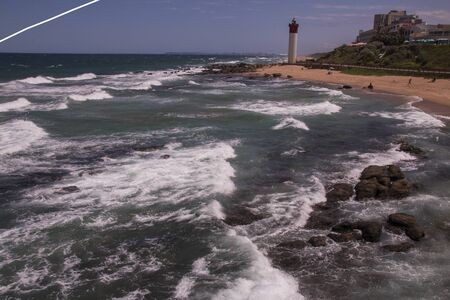 View of umhlanga lighthouse from shallows overlooking rocks