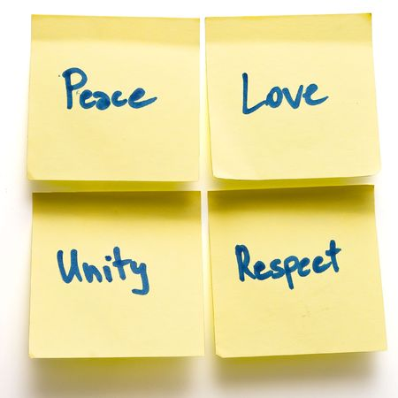 peace love unity respect yellow post-its on a board isolated Stock Photo - 6080067