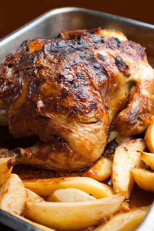 homemade roasted chicken with potatoes Stock Photo - 7024427