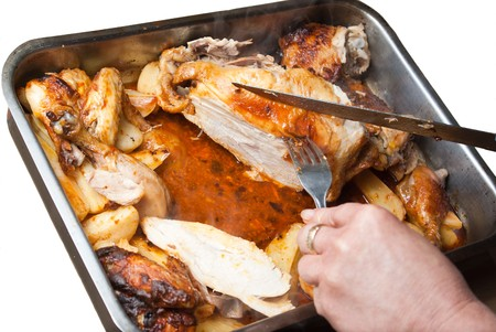 homemade roasted chicken with potatoes isolated Stock Photo - 7024426