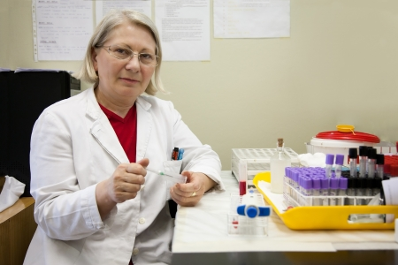 senior female scientist working in the laboratory photo