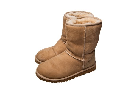 footware: womens sheepskin boots isolated on white Stock Photo