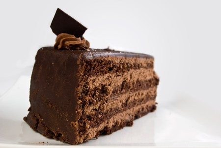 layered chocolate cake with ganache and butter cream filling photo
