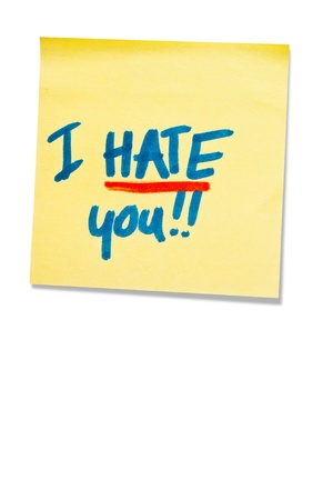post-it note with handprinted i hate you isolated with shadow photo