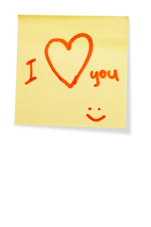 post-it note with handprinted i love you isolated with shadow photo
