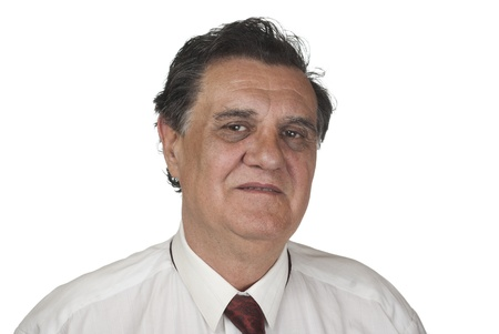 Confident senior businessman against white background Stock Photo - 9354017