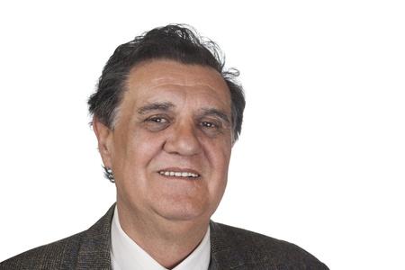 Confident senior executive against white background photo