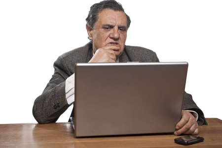Portrait of a worried business man with a laptop isolated on white background Stock Photo - 9354031