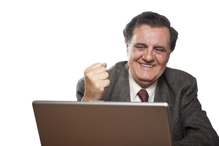 Portrait of a happy business man with a laptop isolated on white background gesturing photo