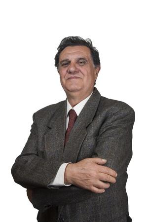 Confident senior businessman against white background photo