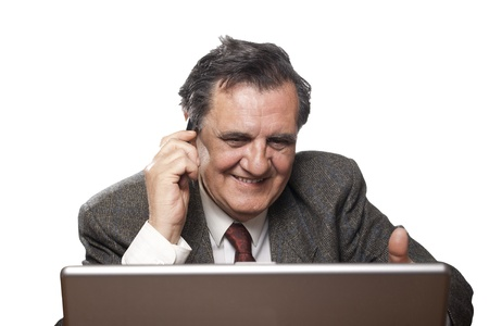 Portrait of a happy business man with a laptop isolated on white background talking on the mobile phone photo