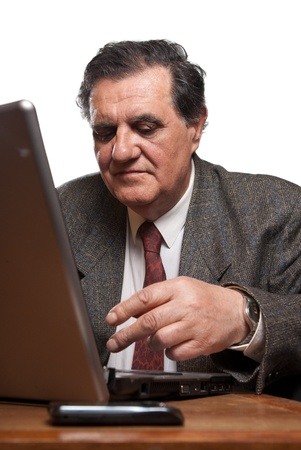 Portrait of a sad and worried business man with a laptop against white background photo