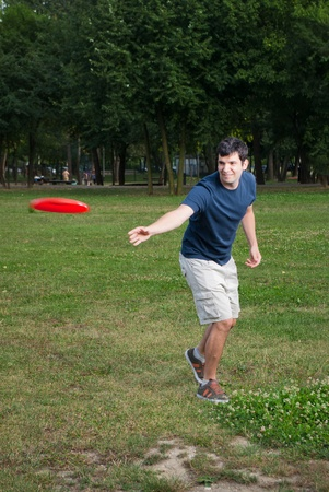 frisbee: young man playing frisbee outdoors