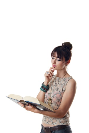 Attractive woman reading a book on white background