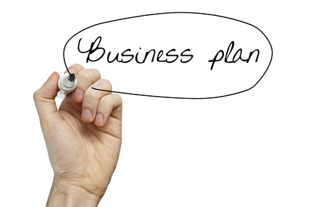 Hand writing Business Plan on whiteboard isolated on white photo