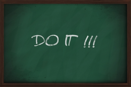 Do it phrase handwritten on a blackboard photo