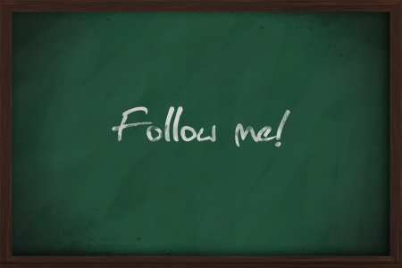 Follow me text handwritten on a chalkboard photo