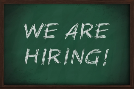 We are hiring job advertisment handwritten retro style on blackboard photo