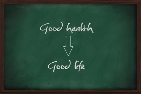 Good health leads to good life written on chalkboard