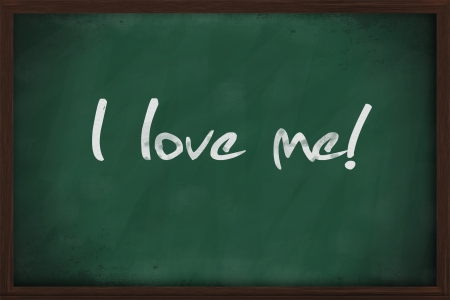 I love me written on green chalkboard photo