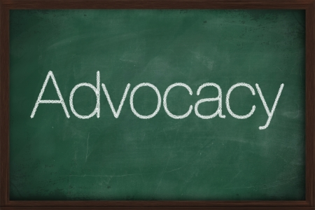 The word Advocacy handwritten with white chalk on a blackboard photo