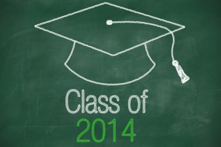 Conceptual Class of 2014 statement written on black chalkboard and graduation cap photo