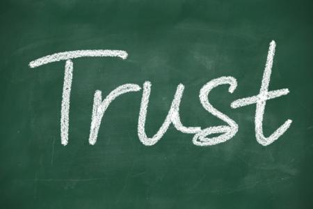 trust written with chalk on a blackboard photo