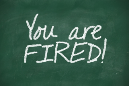 unemployed dismissed: You are fired written on a blackboard Stock Photo