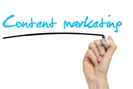 web marketing: Hand writing Content Marketing with blue marker on transparent wipe board