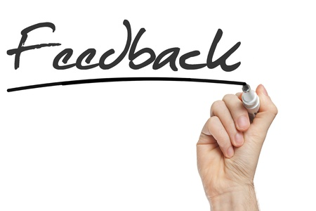 Hand writing Feedback with black marker on transparent wipe board. Stock Photo - 22178957