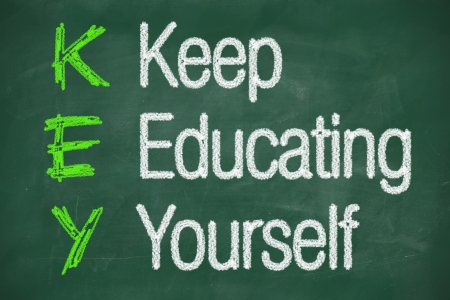 Keep education yourself written on a chalkboard concept Stock Photo