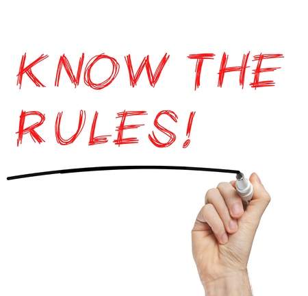 Hand writing Know The Rules with red marker on transparent wipe board photo