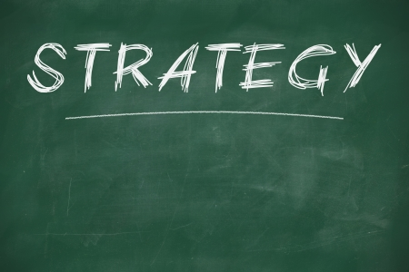 Strategy written with chalk on a blackboard Stock Photo - 22178977