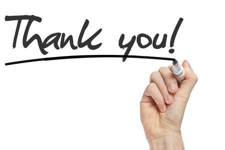Hand writing Thank You with black marker on transparent wipe board. photo