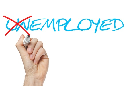 in need of space: Find a new job. Hand turning the word Unemployed into Employed with red marker isolated on white. Stock Photo