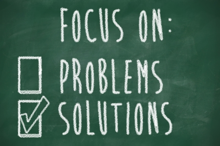focus on solutions concept, handwritten on blackboard