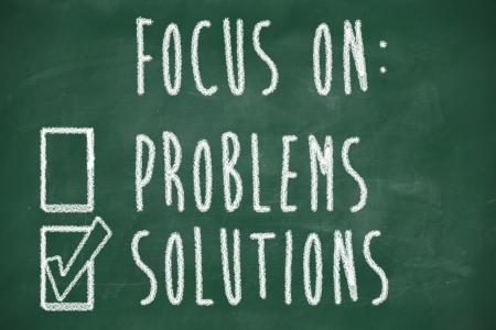 Focus op oplossingen concept, met de hand geschreven op blackboard Stockfoto - 22253687