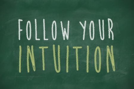 intuition: follow your intuition phrase handwritten on blackboard Stock Photo