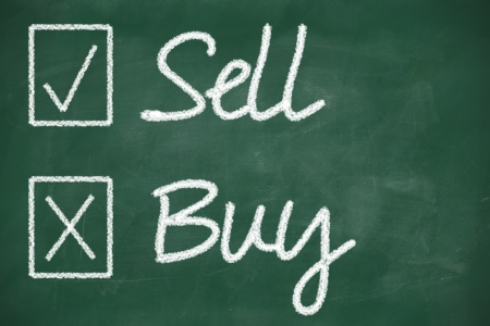 Sell and buy choice business concept on blackboard photo