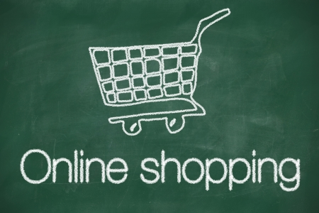 Online shopping cart concept chalk drawing on blackboard photo