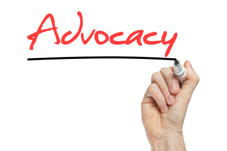 urging: The word Advocacy handwritten with marker on whiteboard