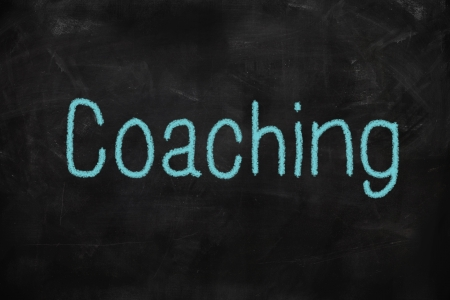 Coaching word written on a blackboard with chalk photo