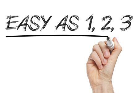 as: Easy as 1 2 3 phrase written on a whiteboard Stock Photo