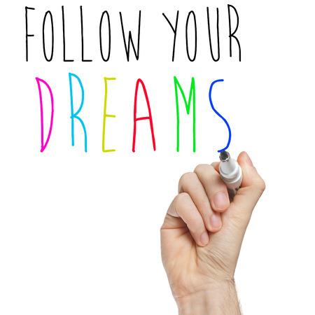 inclination: follow your dreams phrase handwritten on whiteboard