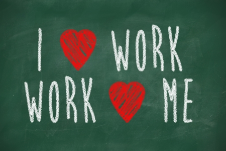 I love work, work loves me phrase handwritten on chalkboard photo