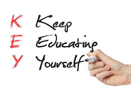 Keep education yourself written on a whiteboard isolated photo