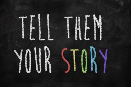 Tell them your story written on blackboard photo